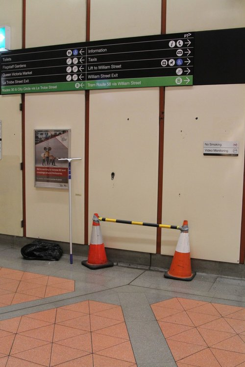 Witches hats at Flagstaff station mark where a JCDecaux digital billboard used to be