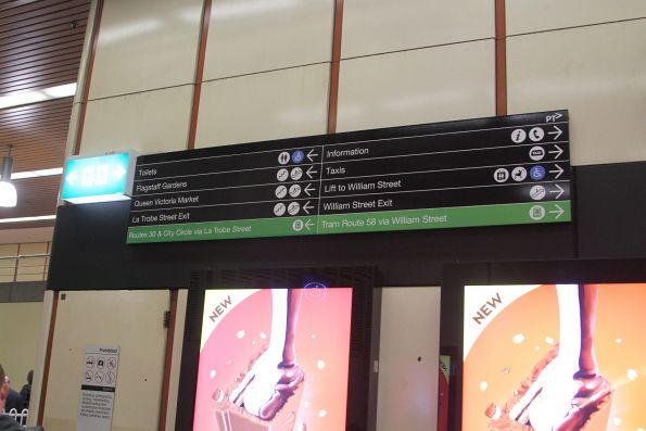 Directional signage moved upwards at Flagstaff station to permit the new Adshel screens to be seen