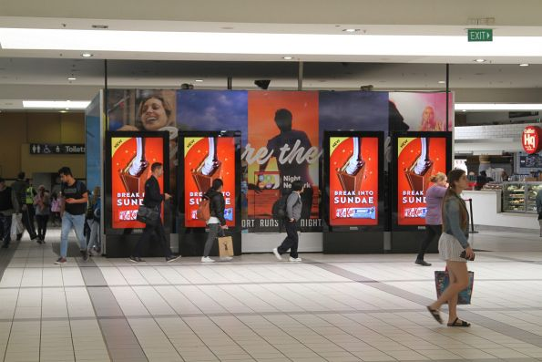 New Adshel digital advertising screens fill the concourse at Flinders Street Station