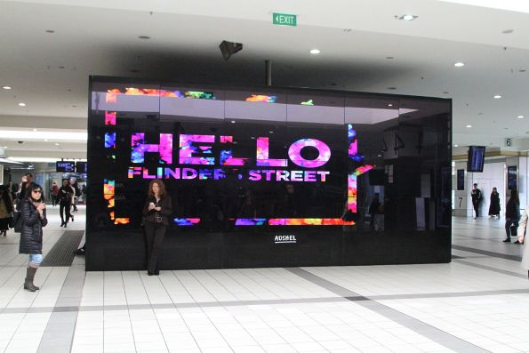 'Hello Flinders Street Station' message on the massive Adshel digital advertising screen