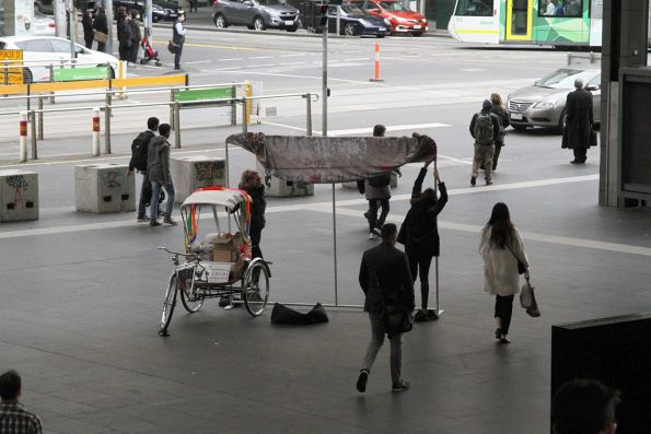 Rickshaw advertising 'Long Chim' restaurant blocks the main entrance to Southern Cross Station