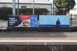 'Huxaburger' and 'St Aloysious College' advertisements at Footscray station platform 6