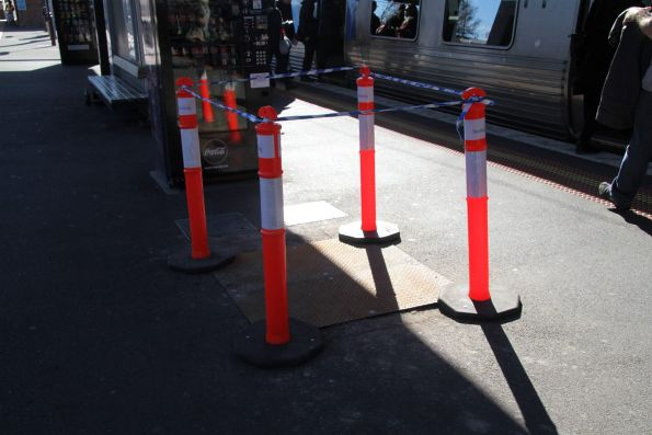 Bollards mark the future site of an advertising panel on the platform at North Melbourne station