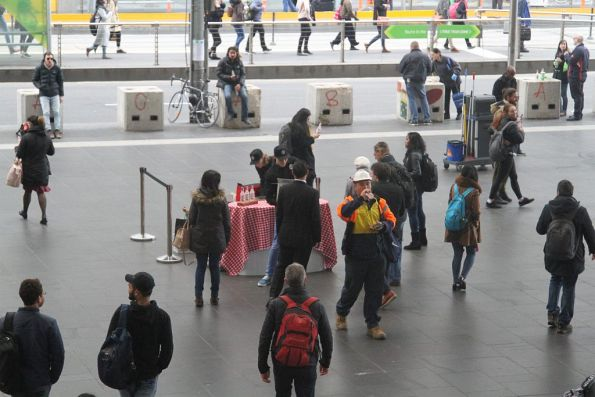 Handing out free drink samples at the main entrance to Southern Cross Station