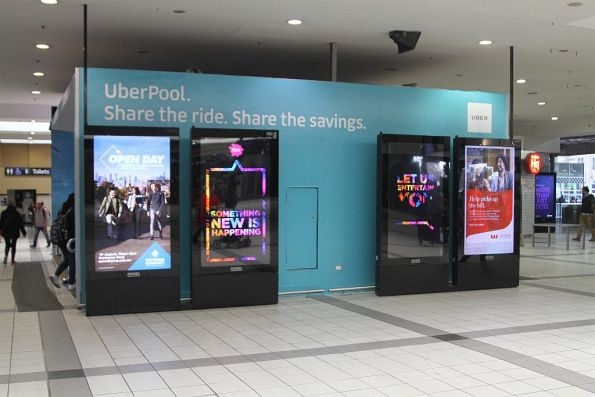 Advertisement for 'UberPool' on the concourse at Flinders Street Station