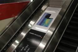 Huawei mobile phone advertisements on the escalators at Melbourne Central