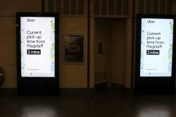 Uber advertisement at Flagstaff station, now advertising a 2 minute pick up time
