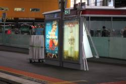 JCDecaux staff change over advertising posters at Southern Cross Station
