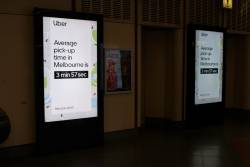 Uber advertisement at Flagstaff station, advertising 'Average pick up time in Melbourne is 3 min 57 sec'