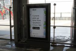 Uber advertisement at Southern Cross Station, advertising a 4 minute pick up time