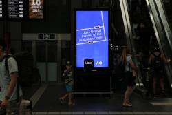 Uber advertisement on the screens at Southern Cross Station