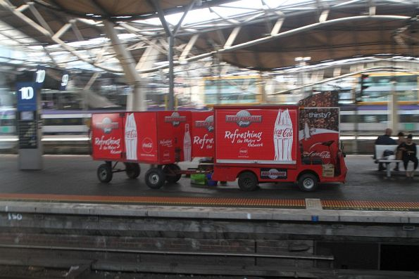 Red Engine Group electric buggy refilling the vending machines at Southern Cross Station