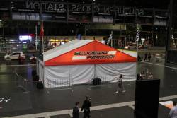 Grand Prix merchandise stores block the main entrance to Southern Cross Station