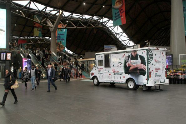 Papa Giuseppi's pizza truck locked up and doing nothing on the main Southern Cross Station concourse