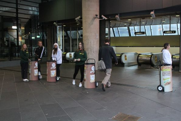 Handing out free muesli bars at Flagstaff station