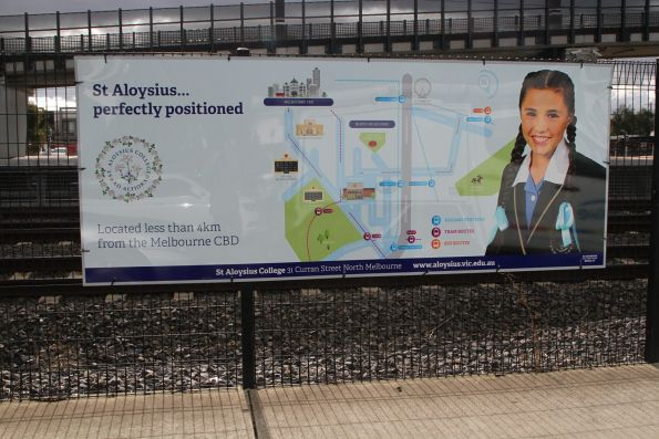 Advertisement for St Aloysius College at West Footscray station