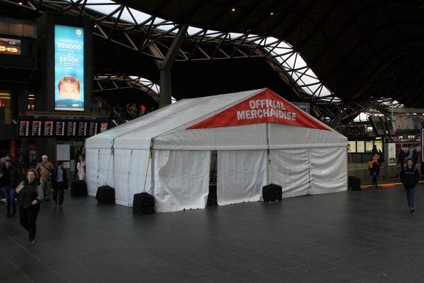'Official Merchandise' stall blocks the Spencer Street entrance to Southern Cross Station