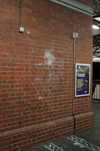 Blank section of wall at Glenferrie station, formerly covered by an advertising panel