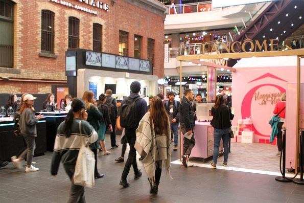 Three different retail stalls conspire to block the main entrance to Melbourne Central station