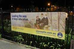 'St Joseph's College' advertisement at Ferntree Gully station