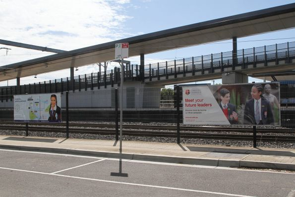 Advertisements for local private schools at West Footscray station