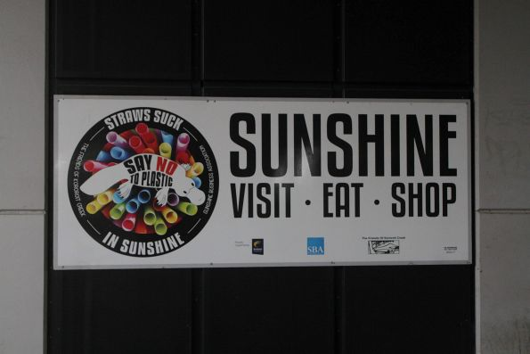 'Sunshine - Eat - Visit - Shop' advert at Sunshine station