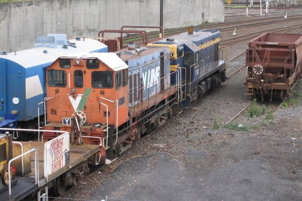 Y168 and T413 on an empty sleeper train at the Wagon Storage Yard