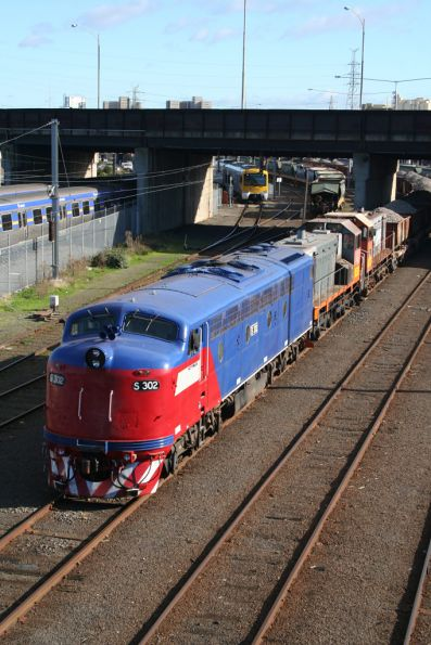 S302 now owned by El Zorro, with Y145 and Y168 at Melbourne Yard on a ballast train