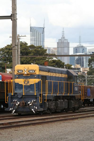 T413 at Melbourne Yard between running works trains