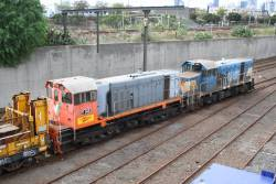 Y145 and T369 on a rail train at Melbourne Yard