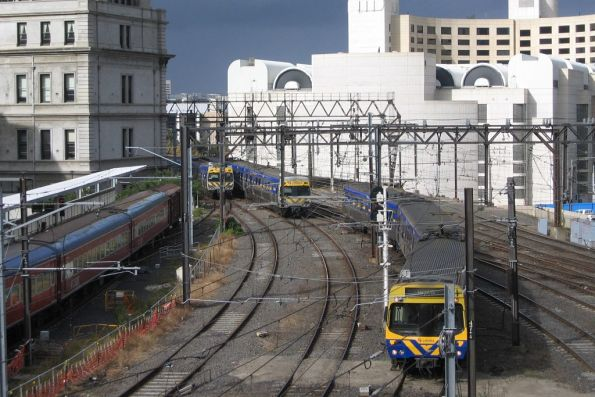 Alstom and EDI Comeng trains pass at Spencer Street Station