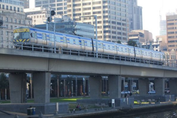 3-car Alstom Comeng passes over the viaduct between Spencer and Flinders Street Stations