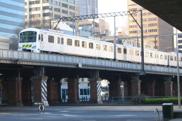 'Nude' Siemens 805M on a down Frankston service passes over the Flinders Street Viaduct