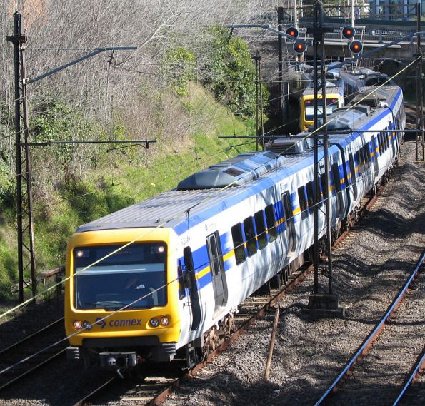 Pair of X'Trapolis trains pass on the down side of Hawthorn