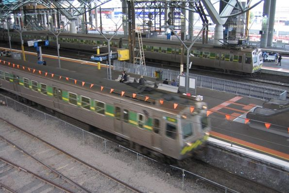 Hitachi 88M and 129M cross paths at Southern Cross Station