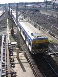 Alstom Comeng 597M leads an up service into Southern Cross Station