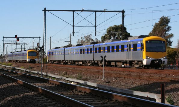 Up and down Werribee services operated 3-car Siemens sets pass at Newport South