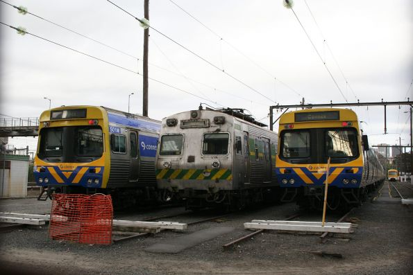 Comeng 501M, Hitachi 37M and a second Comeng train stabled at North Melbourne