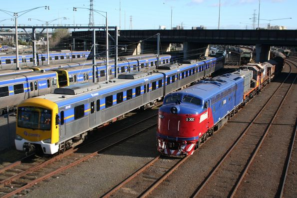 Siemens train 801M at Melbourne Yard, passing S302, Y145 and Y168 on a ballast train
