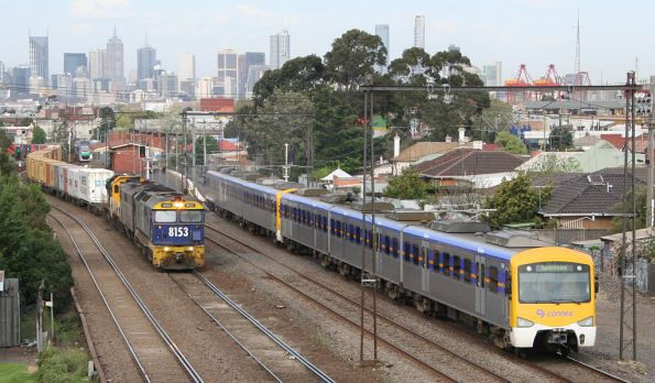 Siemens train overtakes 8153, GM36, Txxx, T40x on a down standard gauge freight train at Middle Footscray