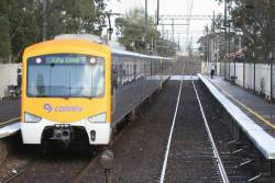 Up Siemens stops for passengers at Springvale