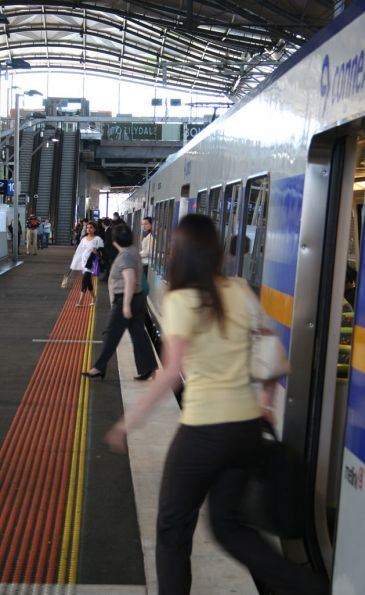 Passengers depart an X'Trapolis at Southern Cross