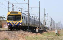 Comeng train on a down Werribee service passes the former Galvin station site