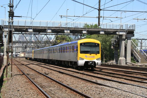 Siemens 753M trails an up Sydenham service at North Melbourne