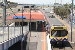 EDI Comeng picks up passengers on the down at Laverton