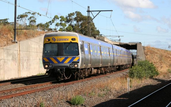 Alstom Comeng emerges from under the Jacana Flyover