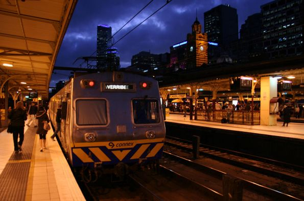 Refurbished Hitachi train awaiting departure from Flinders Street Station