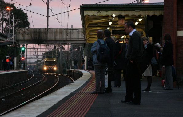 Commuters wait for an up train at Footscray
