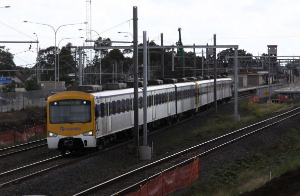 Up Siemens departs the construction site that is Laverton station