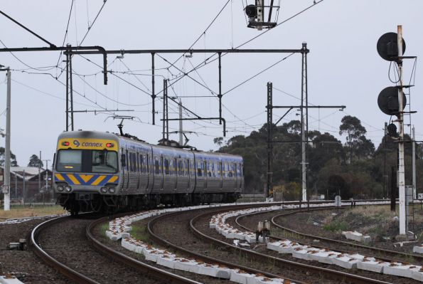 3-car Alstom Comeng departs Newport bound for Werribee, passing new concrete sleepers